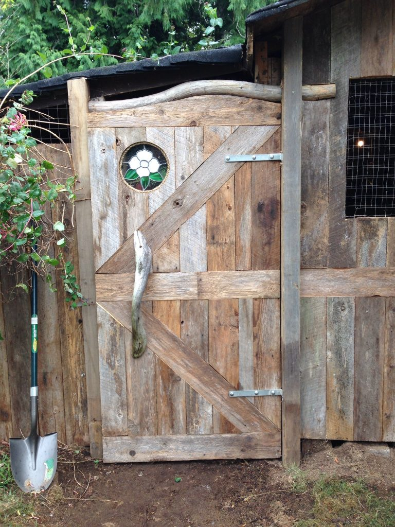 Chicken coop door with stain glass.
